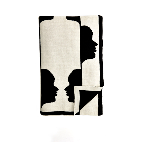 Pulp Design Studios Kismet Lounge Collection Gemini Reversible Throw Blanket in Black and White featuring a graphic pattern of the astrological twins faces