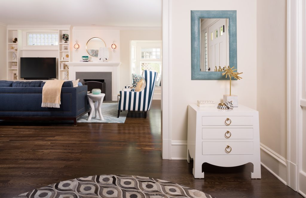 Fearless Style Fit for a Family, Entryway featuring graphic rug, white credenza, blue mirror, coastal style family home
