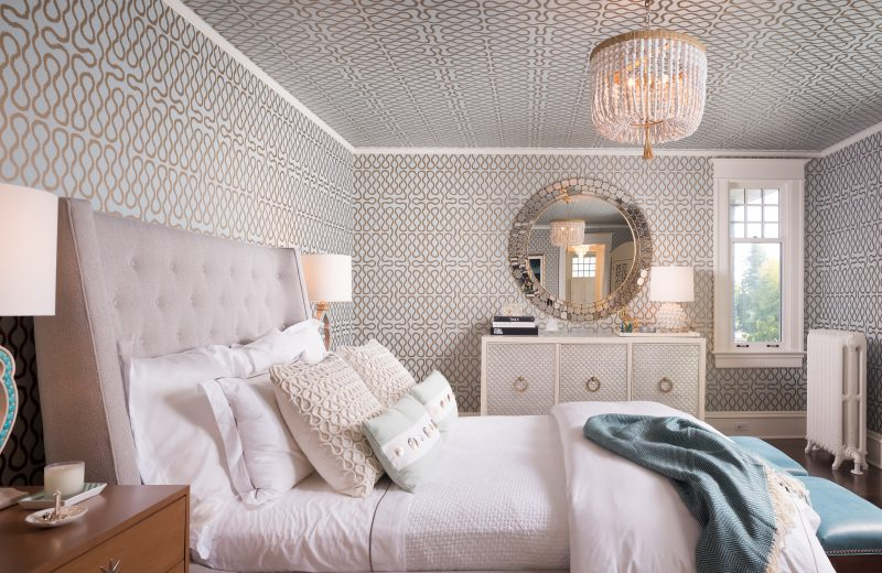Fearless Style Fit for a Family, Master Bedroom featuring geometric and classic wallpaper, blue metallic wallcovering, white beaded chandelier, jewel box style master bedroom, circle accented mirror, coastal style family home