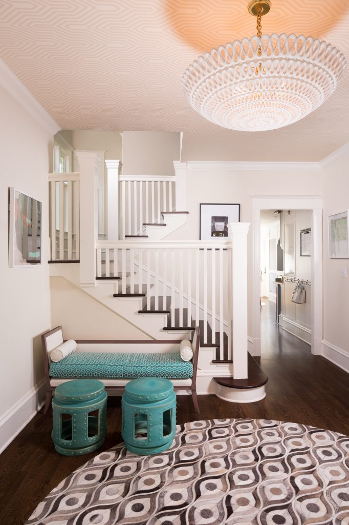 Fearless Style Fit for a Family, Entryway featuring Turquoise stools and bench seating, graphic rug, white railing, coastal style family home