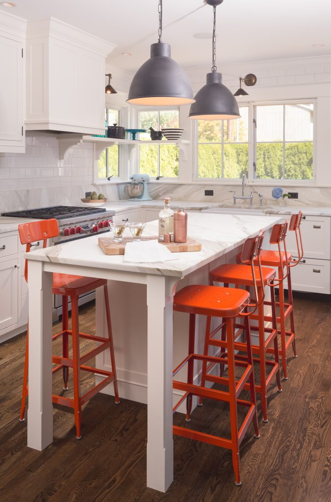 Fearless Style Fit for a Family, Kitchen featuring colorful orange bar stools, black pendant lighting, modern coastal style family home