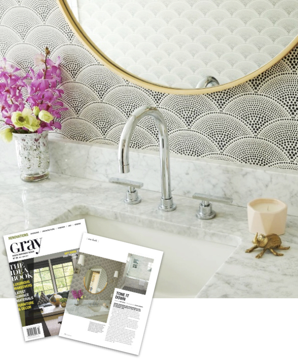 How to Style a Magazine Worthy Bathroom - Gray Magazine, How to Style a Magazine Worthy Bathroom, graphic wall covering, art deco bathroom, bold frame mirror, round mirror, modern mirror, modern bathroom, DXV faucet, marble counter, marble bathroom, beetle accessory