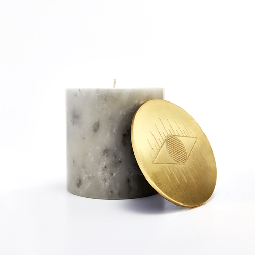 Pulp Design Studios Kismet Lounge Collection Eye of Ra Marble Candle in White with Brass Lid featuring a single graphic eye