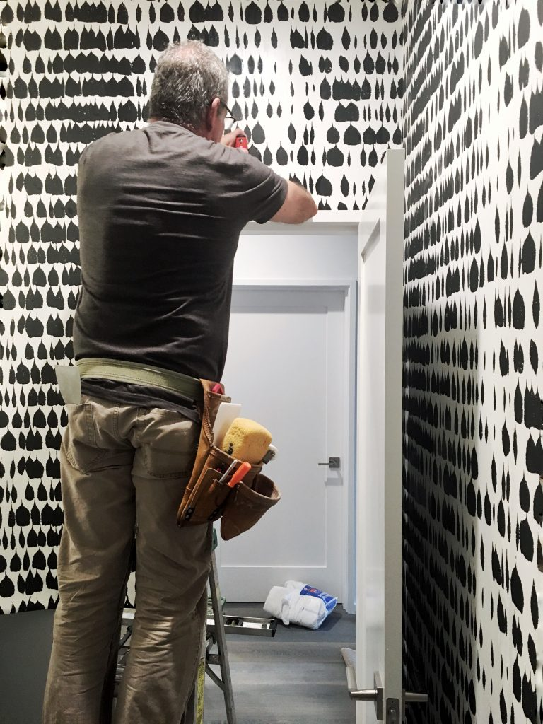 Queen of Spain wallcovering install, back and white pattern wallcovering