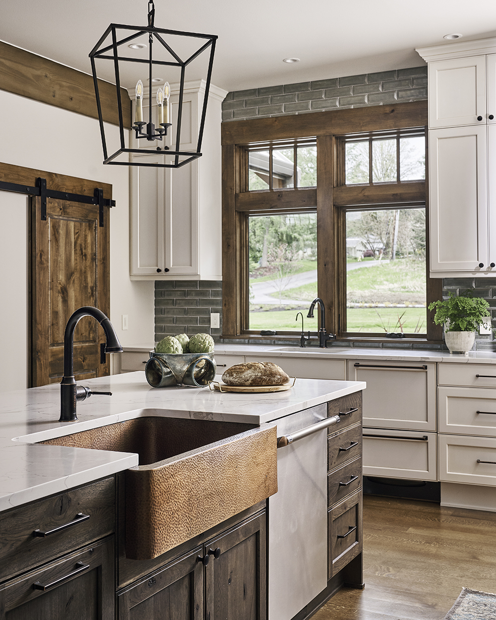 copper sink, thompson traders, oil rubbed bronze, dxv plumbing, ann sacks glass tile, barn door slider, island pendants, windows in kitchen, prep sink design, where to put a prep sink