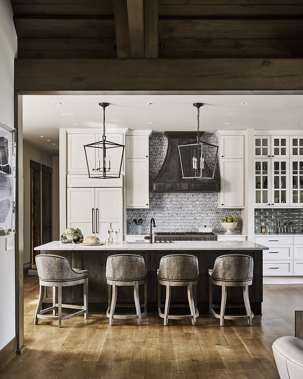 white kitchen design, transitional kitchen design, island with barstools, transitional glass backsplash, black kitchen pendants, kitchen design, kitchen inspiration, seattle kitchen designer, woodinville kitchen designer, wood ceiling, white kitchen wood island